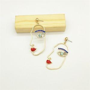 H&M | rhinestone face earrings